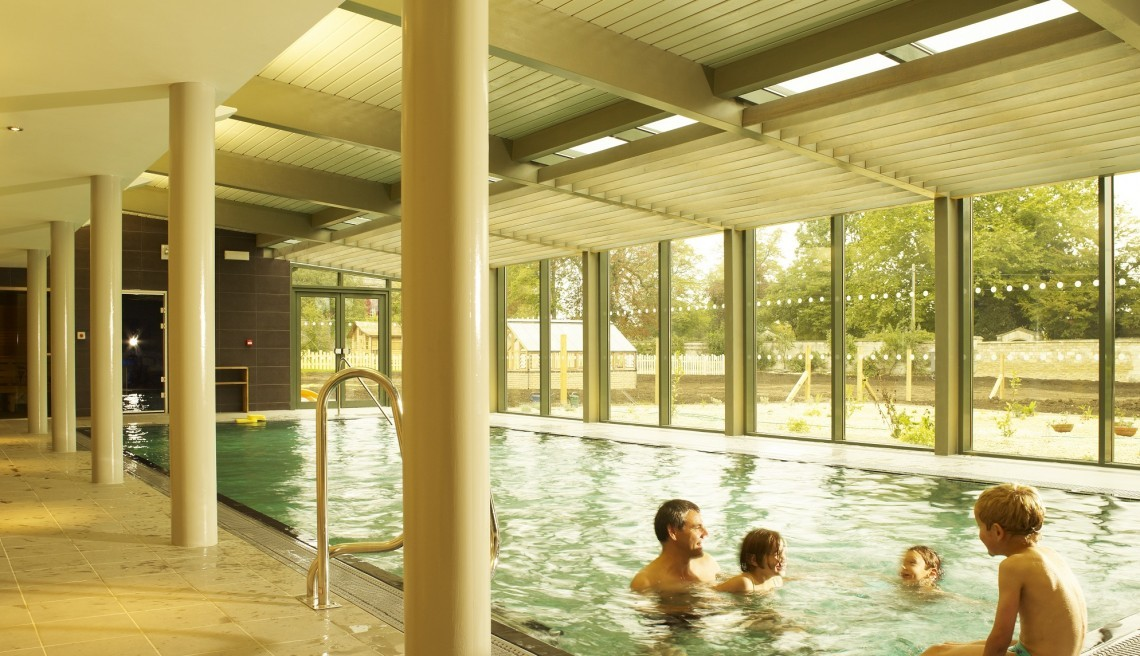 A family play in the pool at Woolley Grange luxury family hotel in Bradford on Avon