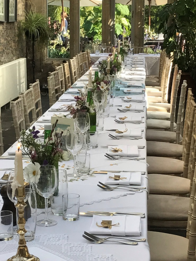 A long dining table set for a wedding.