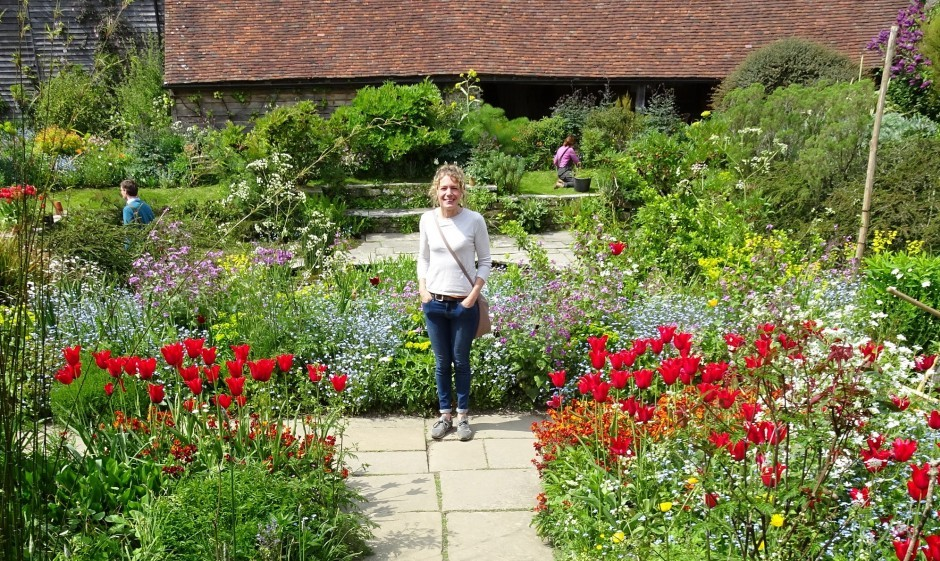 Woolley Grange's Head Gardener, Eliza, stands in a beautiful garden