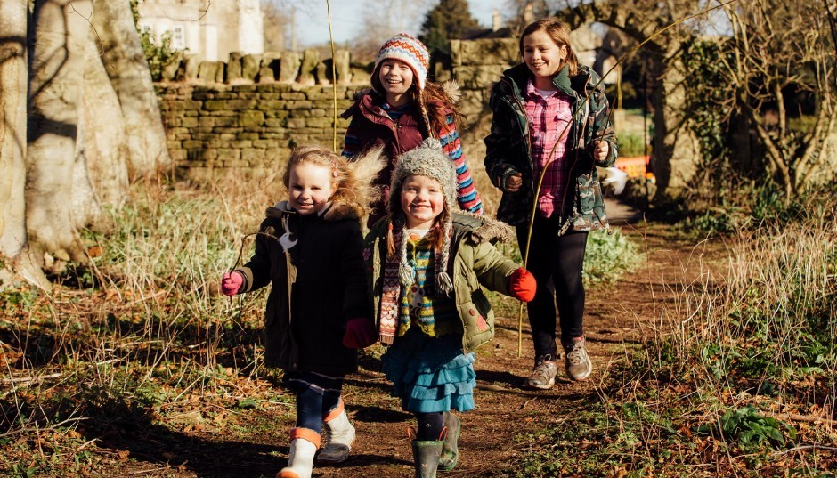 Children walk through the Woolley Grange Hotel grounds in autumn