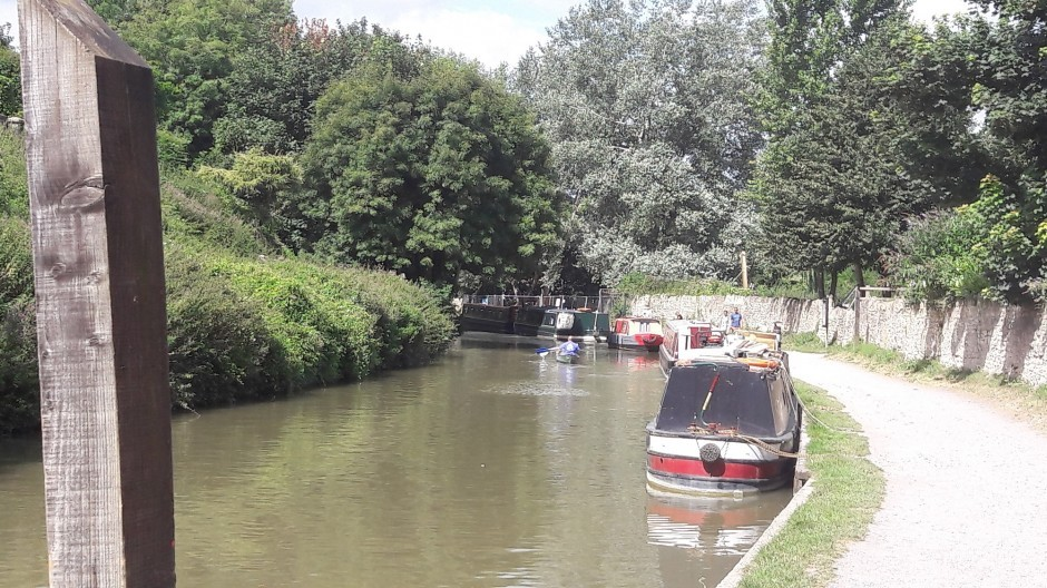 A man canoes down Kennet and Avon Canal near Woolley Grange luxury family hotel in Bradford on Avon