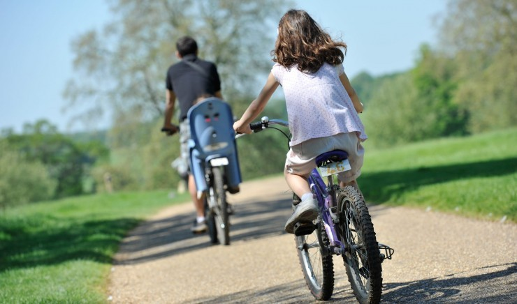A family cycles in the Bradford on Avon country near Woolley Grange luxury family hotel