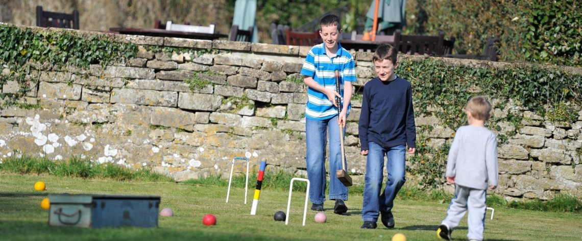 Playing croquet in the grounds of Wiltshire hotel Woolley Grange