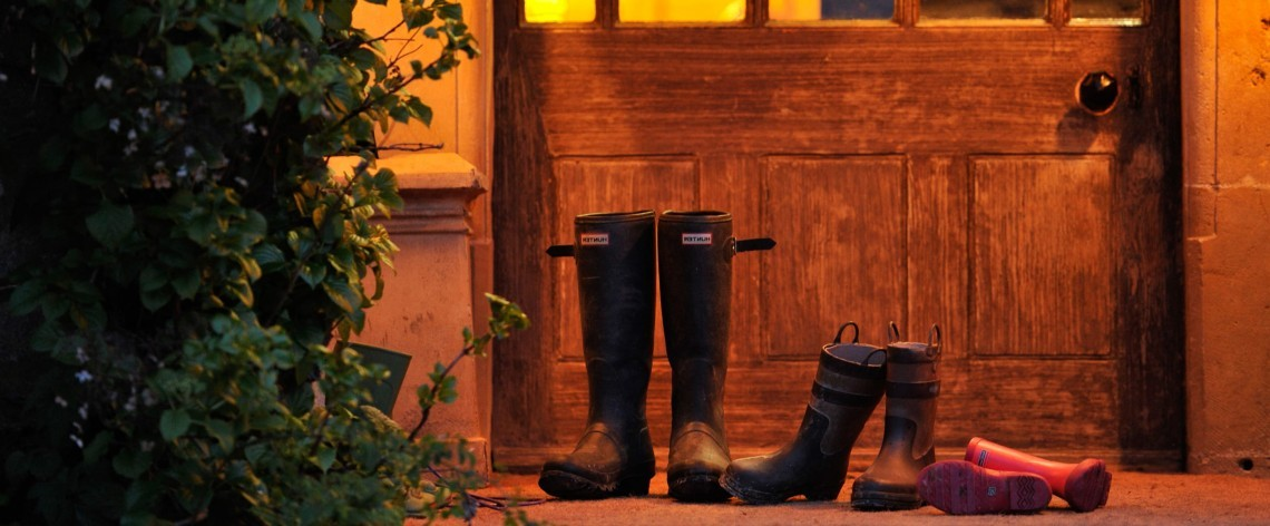 Wellington boots outside the front door of the Wiltshire family hotel Woolley Grange