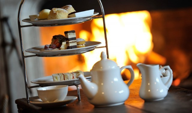 Afternoon tea by the fire at the Woolley Grange Hotel in Wiltshire