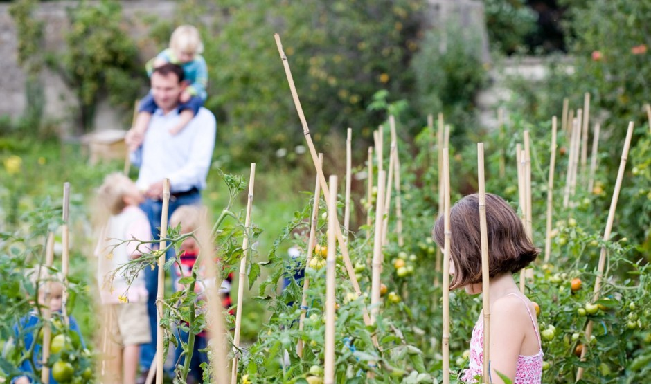 Family in the kitchen garden at Wiltshire hotel Woolley Grange