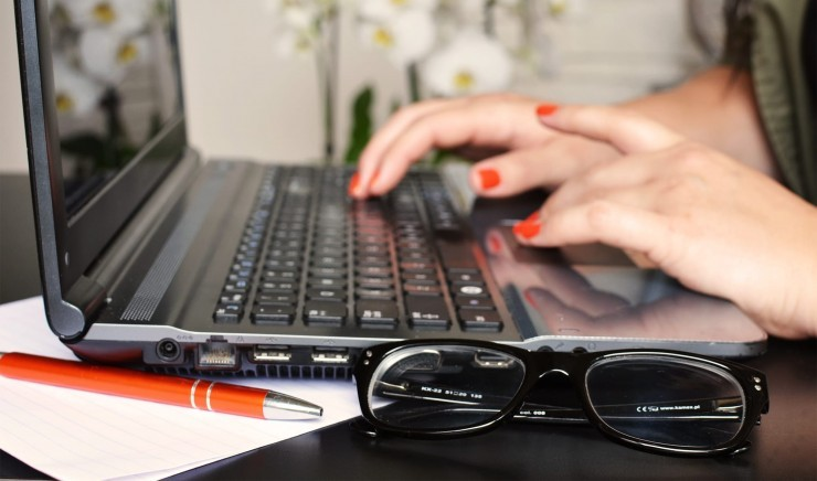 Typing on a computer during a meeting at Wiltshire corporate venue Woolley Grange