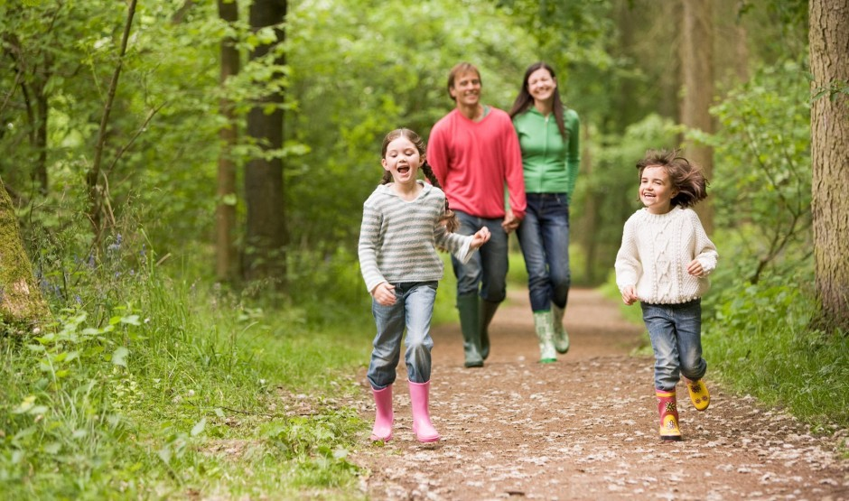 A family walks through the woods near Woolley Grange luxury hotel in Wiltshire