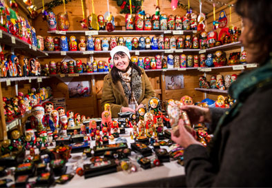 A woman at the Bath Christmas Market sells matryoshka dolls
