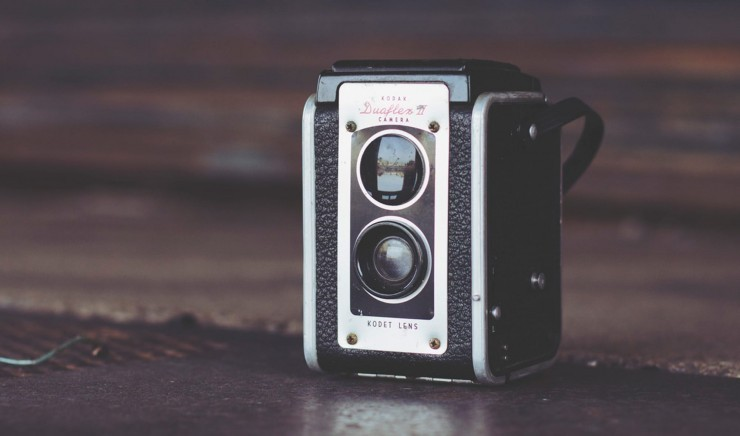 An early camera, like the ones seen at the Museum of Photography