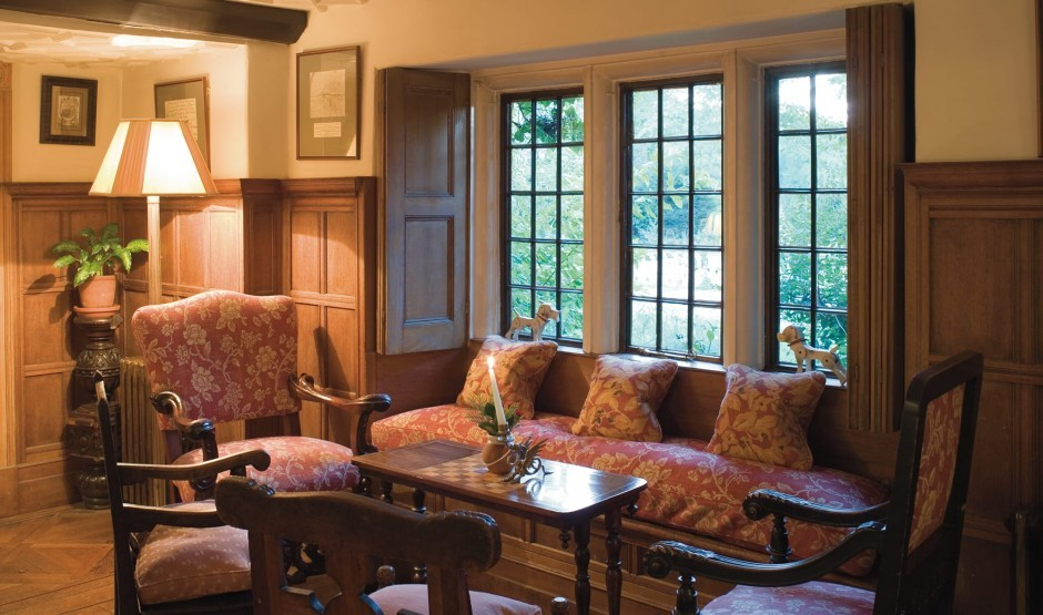 Wood panelling and sofas at our historic country house hotel in Wiltshire