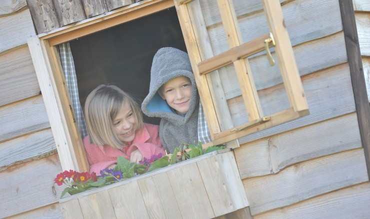 Children in a play house at a family-friendly hotel in Bradford-on-Avon