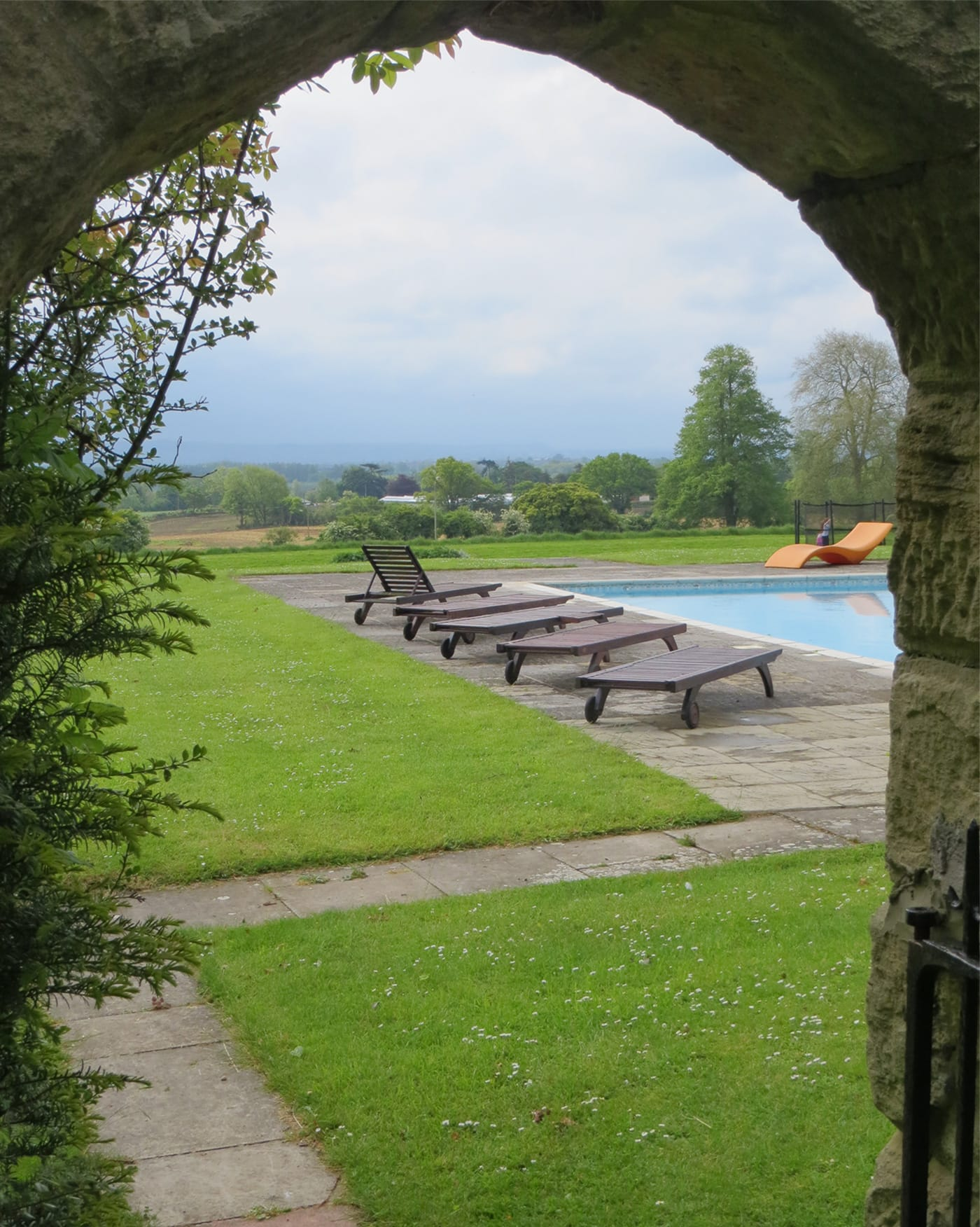 The outdoor pool at Woolley Grange luxury family hotel in Wiltshire