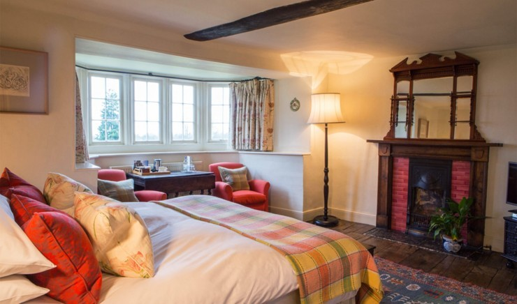 Classic double room with fireplace at Wiltshire hotel Woolley Grange