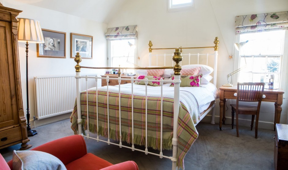 Antique style bed in a small double room