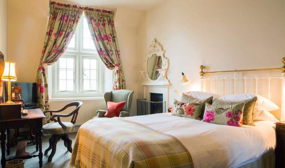 Double bed in a family room at Wiltshire hotel Woolley Grange