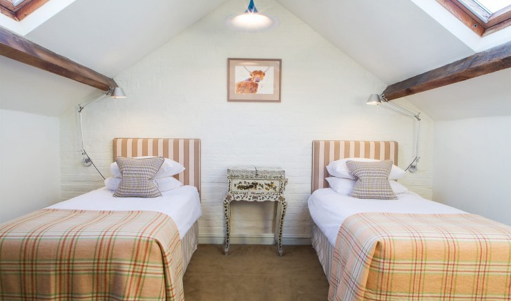 Single beds in the Hayloft two-bedroom suite