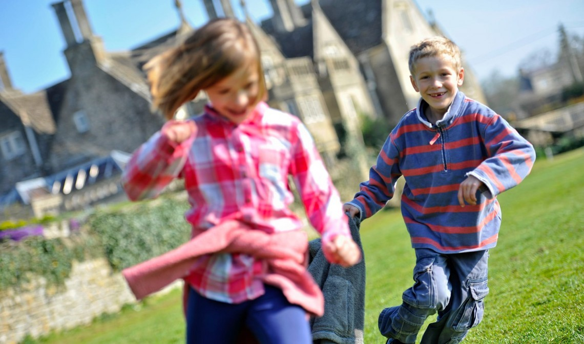 Children playing outside family-friendly hotel Woolley Grange